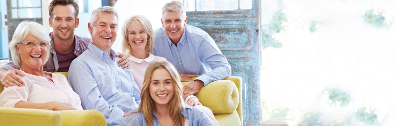 Happy family with three generations of healthy teeth