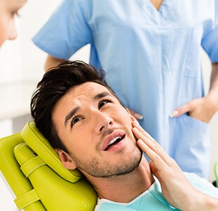 man in pain from a toothache